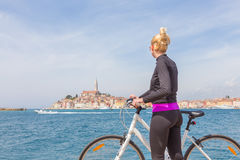 Young active woman cycling round Rovinj, Istria, Croatia. Stock Photography