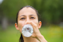 Young active woman drinking water outdoor Stock Photos