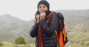 Young active woman hiking in winter Royalty Free Stock Photography