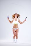 Young active woman with jump rope in studio.  Stock Photo