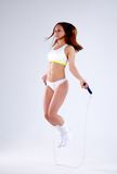 Young active woman with jump rope in studio.  Stock Photography