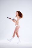 Young active woman with jump rope in studio.  Stock Images