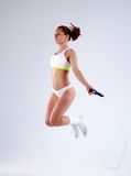 Young active woman with jump rope in studio.  Royalty Free Stock Images