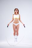 Young active woman with jump rope in studio.  Stock Image