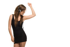Young active woman listening to music from headphones Royalty Free Stock Photo