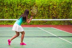 Young active woman playing tennis on tropical Royalty Free Stock Images