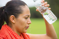 Young active woman splashing water in face Royalty Free Stock Images