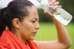 Young active woman spraying water in face Royalty Free Stock Photos