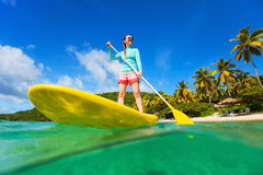 Young active woman on vacation stock photos