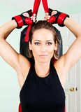 Young active woman workout: cardio kickboxing, punching bag. In homemade gym, fitness Stock Photos