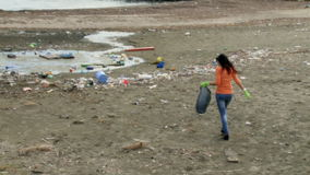 Young activist cleaning destroyed beach stock video footage