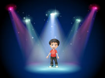 A young actor at the center of the stage Royalty Free Stock Images