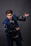The young actor on a dark background Royalty Free Stock Photography