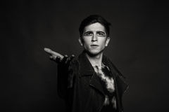 The young actor on a dark background Stock Photography