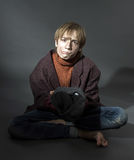 Young actor showing beggar Stock Image