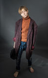 Young actor showing beggar. Old coat and dirty face Royalty Free Stock Image