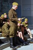 Young actors in military uniform perform Royalty Free Stock Photos
