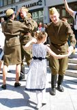 Young actors perform on the street Royalty Free Stock Photo