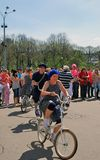 Young actors performing in the Gorky park. Woman and man ride bicycles. Stock Photos