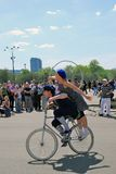 Young actors performing in the Gorky park. Woman and man ride a bicycle. Stock Images