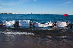 Young actors protest  against law 49.3. Young actors have put on a protest in the water of cannes seaside during the film festival,  against the law of work 49.3 Royalty Free Stock Images