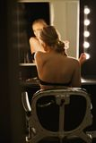 Young actress getting ready backstage Royalty Free Stock Images