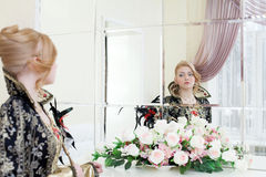 Young actress looking at her reflection in mirror Royalty Free Stock Image