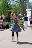 Young actress rotates hula hoop Royalty Free Stock Images