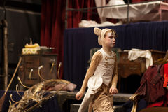 Young actress on stage. Young actress in mouse costume on stage stock photography