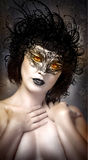 Young actress with venetian mask over fantasy background Stock Photos