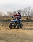 Young adept steering wheel on a small quad. Biskupice Radlowskie, Poland - January 14, 2018: Young adept steering wheel on a small quad Stock Image