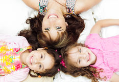 Young adorable hispanic sisters with mother lying Royalty Free Stock Photo