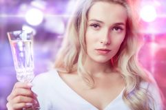 Young adorable woman celebrates carnival in the spotlight royalty free stock image