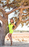 Young adorable woman  portrait near tree Stock Photos