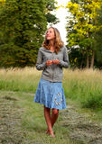 Young  adorable woman on walk in park Stock Photography