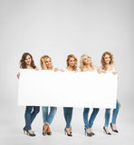 Young adorable women holding a board Stock Photos