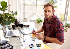 Free Young Aduld Businessman Looking At Camera While Working Royalty Free Stock Image - 67105996