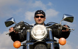 Young adult biker riding a chopper motorcycle Royalty Free Stock Image