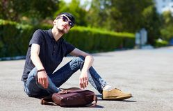 Young adult boy posing on the ground Stock Images