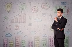 Colorful drawings on wall with businessman Royalty Free Stock Photo