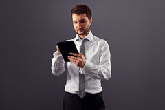 Young adult businessman working with tablet pc Stock Image
