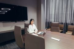 Young adult businesswoman with computer at workplace stock photo