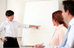 Young adult businesswoman giving a presentation Stock Photography