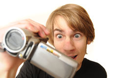 Young adult with camcorder Royalty Free Stock Photo