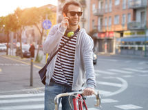Young adult casual dressed calling on the phone in the city stre Royalty Free Stock Photos