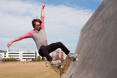 Young Adult Catches Air Skateboarding Off High Concrete Ramp Royalty Free Stock Photography