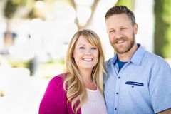 Young Adult Caucasian Couple Portrait At The Park. Young Adult Caucasian Couple Pose for a Portrait At The Park royalty free stock images