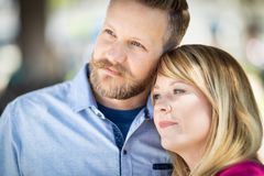 Attractive Young Adult Caucasian Couple Portrait At The Park. Young Adult Caucasian Couple Portrait At The Park stock image
