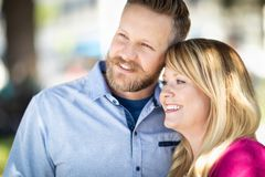 Young Adult Caucasian Couple Portrait At a Park. Young Adult Caucasian Couple Portrait At The Park royalty free stock photo
