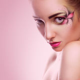 Young adult caucasian woman with flower make up on pink backgrou Stock Photography
